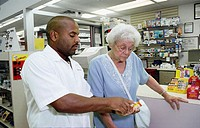 Pharmacist explains medicine to patient