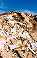 Pile of wood debris and wood chips in recycling yard