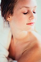 Close-up of a young woman lying with her eyes closed (thumbnail)