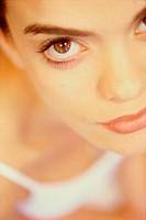 Close-up of a young woman looking at camera