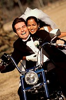Bride and bridegroom on a motorcycle