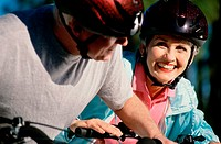 Couple wearing cycling helmet