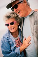 Senior couple standing together laughing