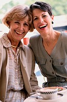 Portrait of two senior women laughing