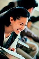 Teenage girl smiling in class