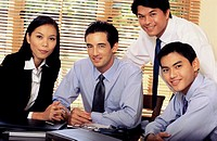 Portrait of a group of young business executives in an office