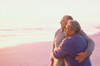Senior couple standing together at the beach
