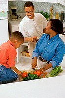Son helping his mother in the kitchen