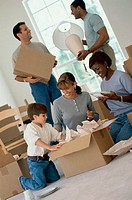 Two young couples unpacking boxes in a new home