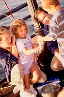 Couple in a fishing boat with their son and daughter
