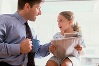 Young businessman talking to his daughter