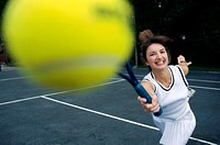 Close-up of a young woman playing tennis