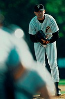 Portrait of a baseball pitcher bending forward (thumbnail)