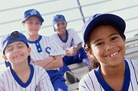 Portrait of boys and girls from a little league baseball team