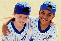 Portrait of two boys from a little league baseball team
