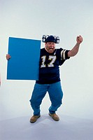 Portrait of a sports fan holding a blank board