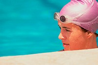 Young female swimmer in a swimming pool