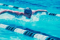 Young man swimmer doing the butterfly stroke