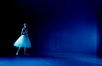 Young woman standing on a stage in a tutu