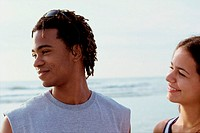 Close-up of a young couple at the beach