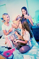 Three teenager girls making hairstyles