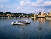 Tour boat on river Vlata . Prague. Czech Republic