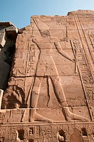 Carving of Egyptian priest in wall at Karnak. Luxor, Egypt