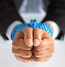 Close up on Two hands Tied Together With a Rope