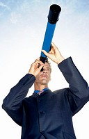 Low Angle View of a Businessman Looking Through a Telescope