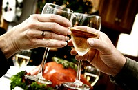 Couple toasting at holiday dinner