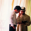Arab businesspeople checking diary