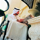 Arab businessman reading newspaper