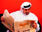 Arab man reading newspaper (thumbnail)