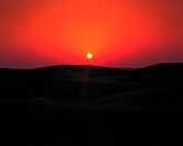 Red sky at sunset over the desert (thumbnail)