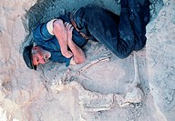 Elderly man sleeping at the archaeological site of Shahr-e-Soukhteh, Sistan province, Iran (thumbnail)
