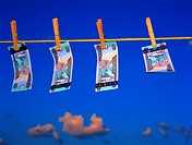 United Arab Emirates banknotes hanging on a clothesline