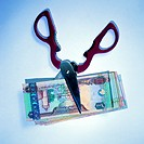 United Arab Emirates banknotes and scissors