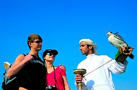 Western tourists visiting Arab falconer in the United Arab Emirates