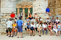 Tourists visiting the Temple of Segeste built 5th century AD in classical doric style probably by the Greek. Sicily. Italy