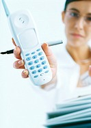 Woman holding out cordless phone