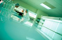 Pharmaceutical lab researchers working in clean room