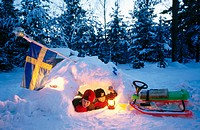 Children, 9 and 14, building a snow cave. Stockholm, Sweden