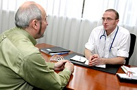 Medical consultation. Doctor talking with a patient during a consultation.