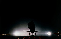 Shuttle Discovery landing. View of the space shuttle Discovery landing at the end of mission STS-96. The parachute deployed behind Discovery is used t...