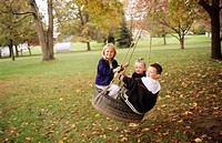 Children on tire swing. USA