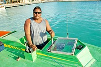 "Fisherman in his ""poti marara"" boat used to fish the mahi mahi. Bora Bora island. French Polynesia. South Pacific."