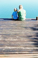 Father and son on a jetty