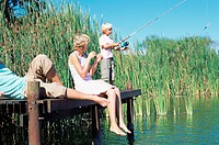 Boy fishing with parents