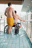 Two men entering swimming pool (thumbnail)