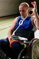Basketball player bandaging his arm